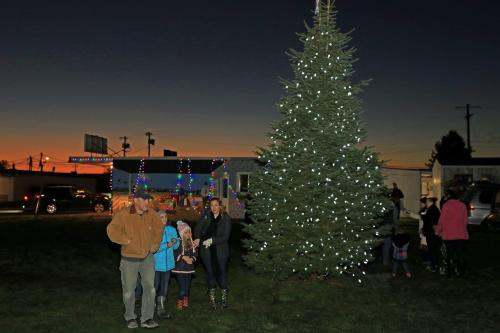 People gathered for an outdoor Christmas Tree Lighting