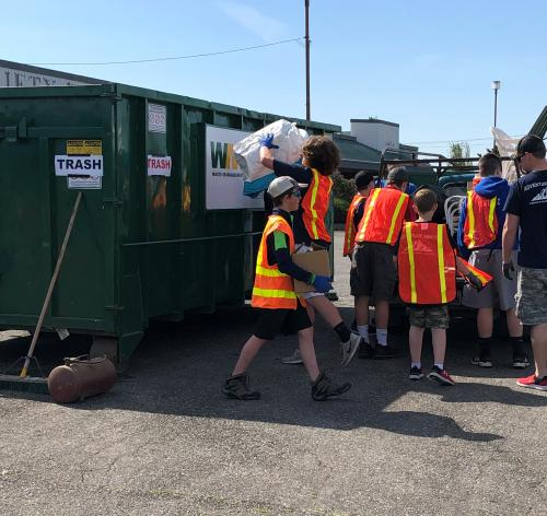 Troop 86 Putting Trash in a Dumpster