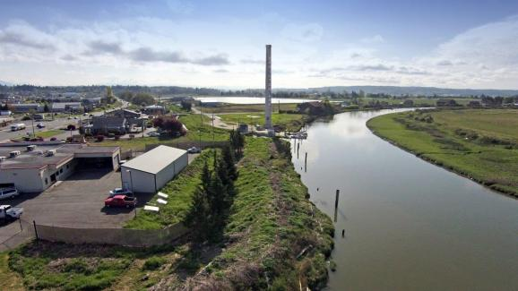 Aerial view of Stanwood businesses by a river